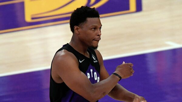 LOS ANGELES, CA - MAY 02: Kyle Lowry #7 of the Toronto Raptors celebrates after scoring a three point basket against the Los Angeles Lakers during the second half at Staples Center on May 2, 2021 in Los Angeles, California. NOTE TO USER: User expressly acknowledges and agrees that, by downloading and or using this photograph, User is consenting to the terms and conditions of the Getty Images License Agreement.   Kevork Djansezian/Getty Images/AFP (Photo by KEVORK DJANSEZIAN / GETTY IMAGES NORTH AMERICA / Getty Images via AFP)
