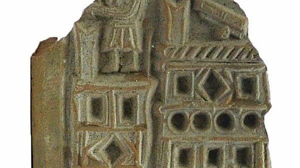 Археологический артефакт, обнаруженный в результате раскопок на Гончарной улице в Москве