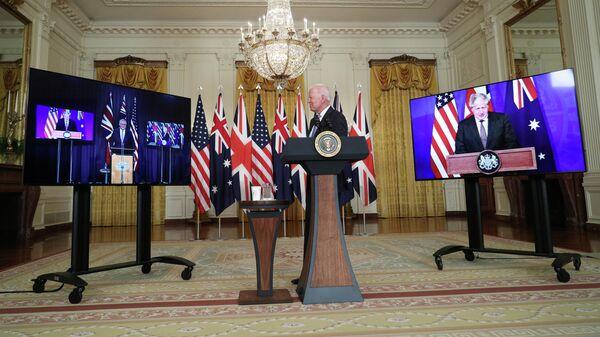 Президент США Джо Байден во время переговоров с премьер-министром Австралии Скоттом Моррисоном и премьер-министром Великобритании Борисом Джонсоном в Белом доме в Вашингтоне