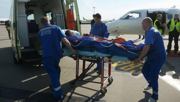 Самолет с раненым сотрудником RT прибыл в Москву