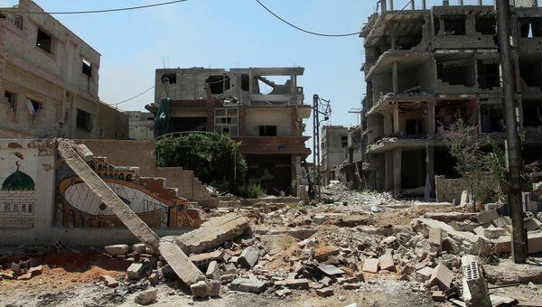 Разрушенные дома в городе Млейха в 10 км от Мадаска. Архивное фото