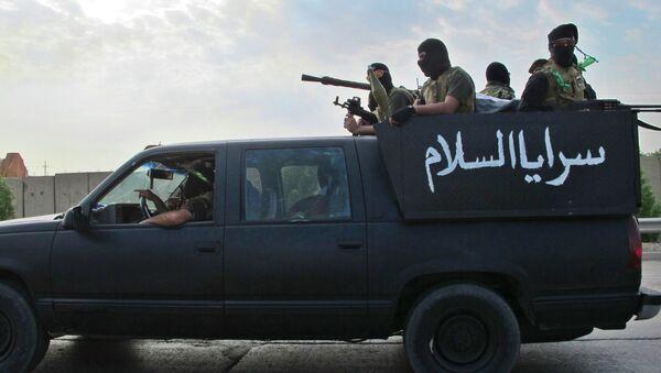 Шиитские боевики патрулируют окраину в западной части Багдада