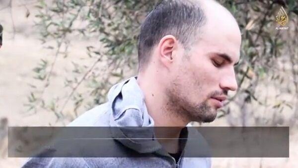 Сергей Ашимов на скриншоте видеоролика al-Hayat Media Center, распространенного в интернете