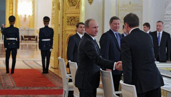 Президент России Владимир Путин перед началом заседания Государственного совета РФ в Кремле