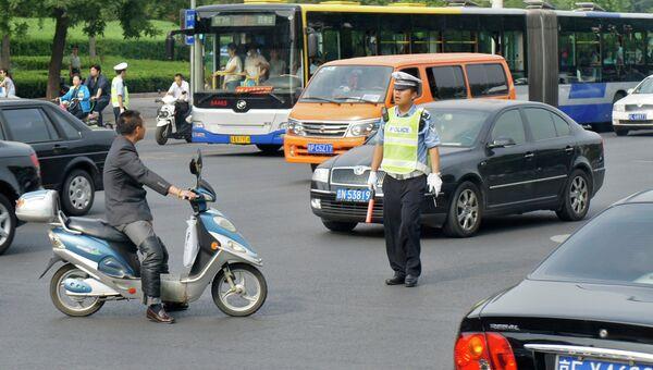 У площади Тяньаньмэнь в Пекине