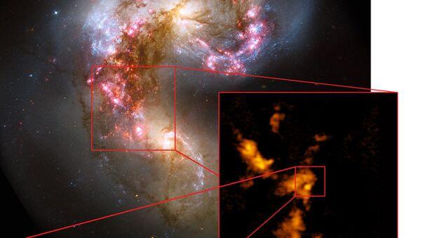 Композитный снимок галактик NGC 4038 и NGC 4039, полученный при помощи ALMA и ряда других телескопов