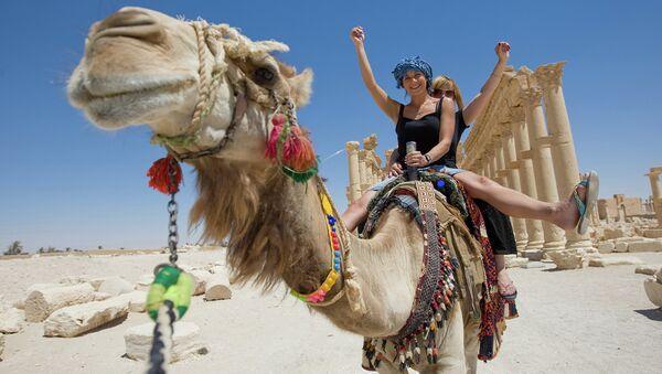 Прогулка верхом на верблюде