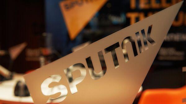 Логотип международного информационного бренда Спутник