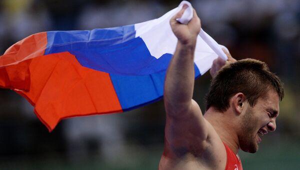 Давит Чакветадзе (Россия) радуется победе на соревнованиях по греко-римской борьбе на I Европейских играх в Баку