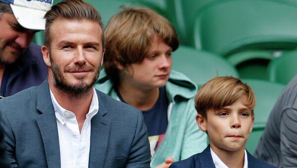 Дэвид Бекхэм с сыновьями на Уимблдонском турнире в Лондоне