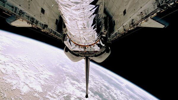 Вывод телескопа Чандра из шаттла 23 июля 1999 года