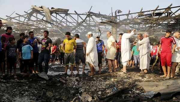 Последствия взрыва на рынке Багдада