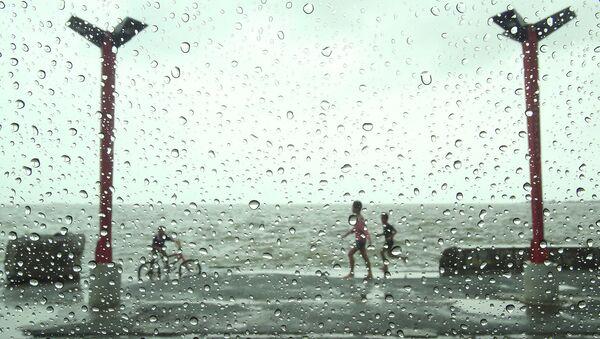 Дождь во время тайфуна. Архивное фото