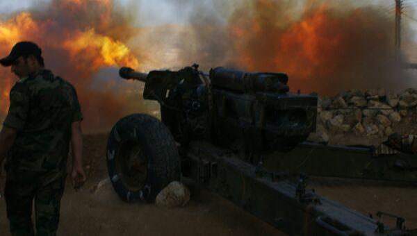 Сирийские военные ведут обстрел позиций исламистов в окрестностях города Эз-Забадани, Сирия