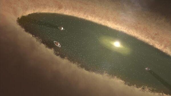 Так художник представил себе протопланетный диск с формирующимися планетами