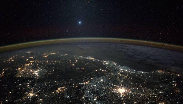 Фотография Венеры с борта МКС, сделанная астронавтом из Японии Кимия Юи. Архивное фото