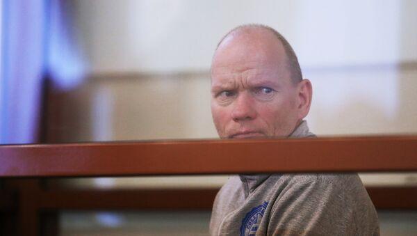 Олег Белов, обвиняемый в убийстве матери, жены и шестерых детей. Архивное фото