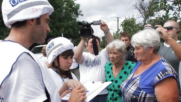 Последствия обстрела села Саханка в Донецкой области