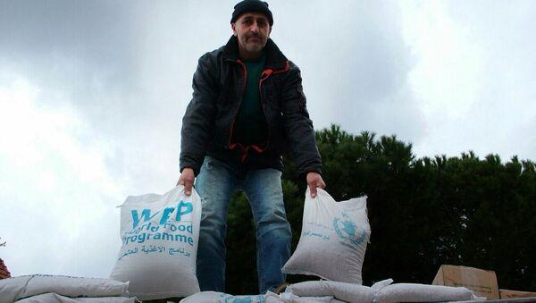 Разгрузка гуманитарной помощи в Латакии. Архивное фото