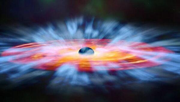 Квазарный ветер вокруг черной дыры