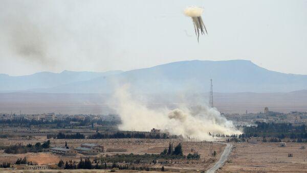 Вид на город Эль-Карьятейн, на который при поддержке артиллерии и вертолетов ВВС Сирии ведет наступление сирийская армия и отряды ополчения. Архивное фото