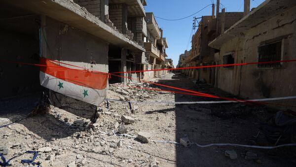 Флаг Сирии на улице Пальмиры, освобожденной от боевиков. Архивное фото
