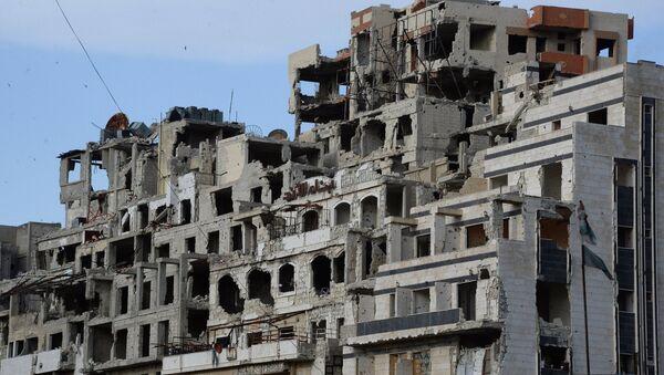 Вид на разрушенные дома в Хомсе.Архивное фото