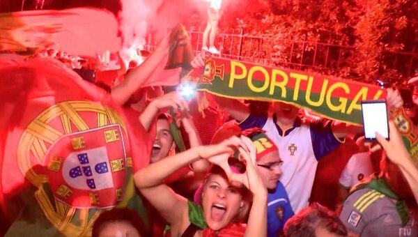 Ликующие португальцы и грустные французы в Париже после финала Евро-2016