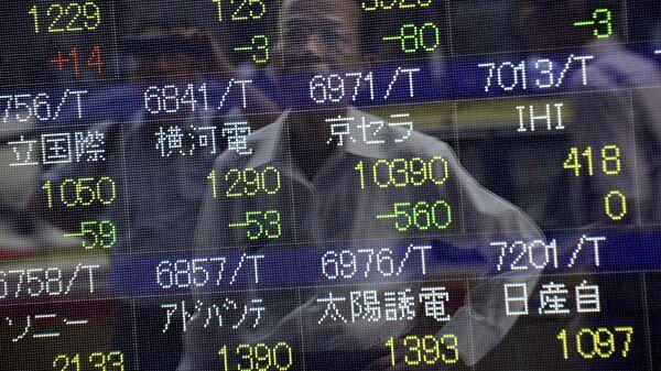 Табло Токийской фондовой биржи. Архивное фото
