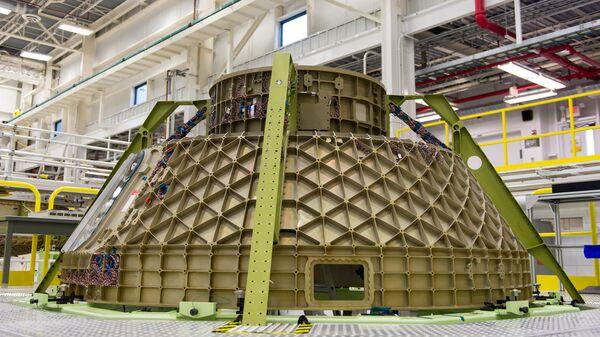 Пилотируемый транспортный космический корабль CST 100 Starliner, разрабатываемый компанией Boeing