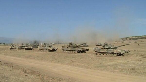 Совершение марша бригадой управления Западного военного округа (ЗВО) и мотострелковой бригадой Южного военного округа (ЮВО)