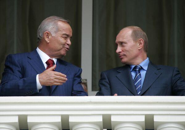 Президент Узбекистана Ислам Каримов и президент России Владимир Путин во время прогулки в сочинской резиденции главы российского государства Бочаров ручей