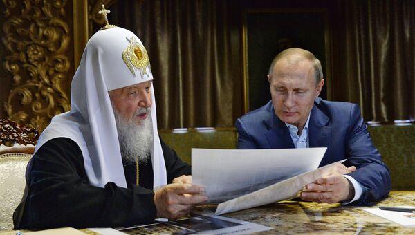 Патриарх Московский и Всея Руси Кирилл и президент России Владимир Путин. Архивное фото