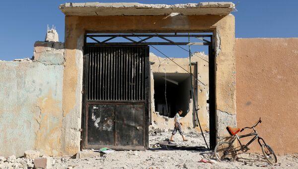 Последствия авиаудара в сирийской провинции Идлиб