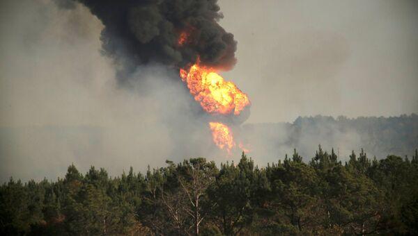 Пожар на месте взрыва трубопровода Colonial Pipeline в округе Шелби, штат Алабама