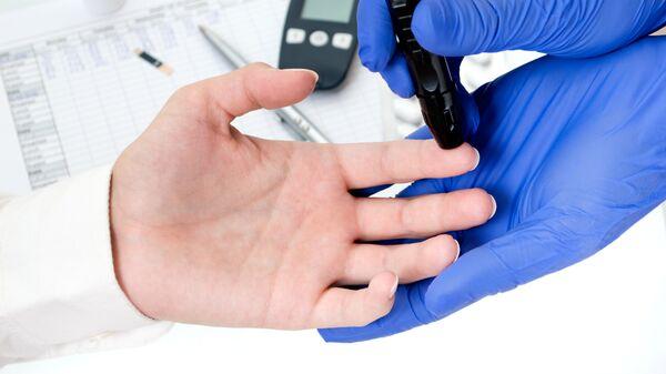 Тест на уровень сахара в крови. Архивное фото