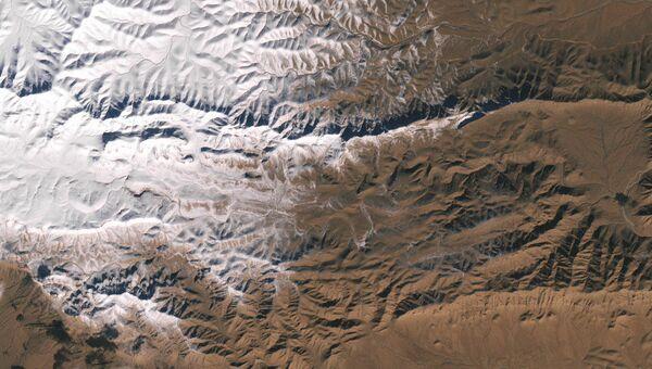 Снимок снега в пустыне Сахара со спутника НАСА