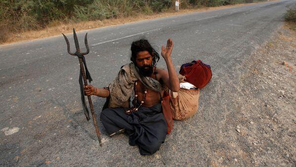 Житель поселения заклинателей змей Jogi Dera в штате Уттар-Прадеш, Индия