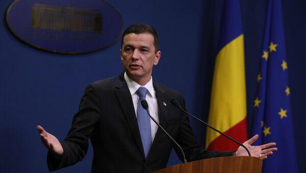 Премьер-министр Румынии Сорин Гриндяну выступает с речью в Бухаресте