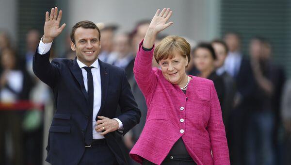 Канцлер Германии Ангела Меркель и президент Франции Эммануэль Макрон во время встречи в Берлине