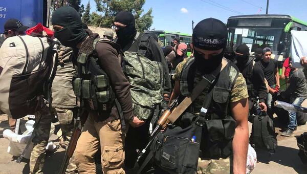 Последний этап вывода боевиков из квартала Аль-Ваэр в городе Хомс. 21 мая 2017
