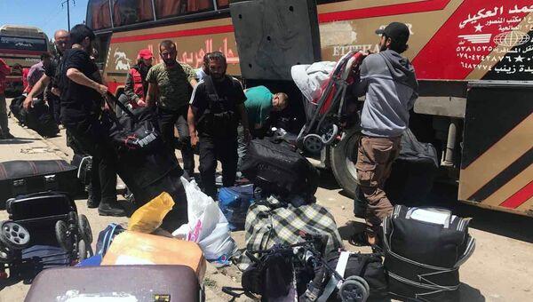 Последний этап вывода боевиков из квартала Аль-Ваэр в городе Хомс