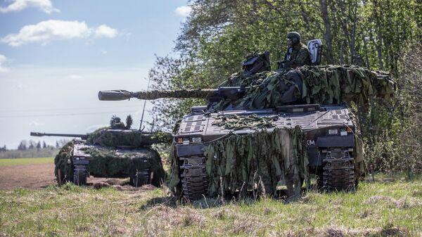 Силы обороны Эстонии совместно с союзниками НАТО во время военных учений Весенний шторм-2017 в Эстонии. 23 мая 2017