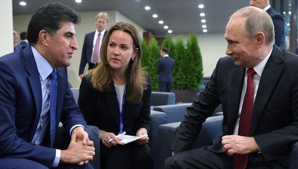 Президент РФ Владимир Путин и премьер-министр Курдского автономного района Ирака Начирван Барзани во время встречи в рамках Санкт-Петербургского международного экономического форума 2017