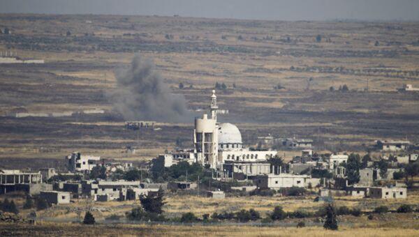 Дым в районе Голанских высот после авиаудара израильских ВВС. 24 июня 2017