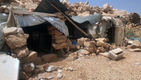 Место базирования террористов Джебхат-ан-Нусра (организация запрещена в РФ) в горном районе Эрсаль на ливано-сирийской границе в долине Увейни. 28 июля 2017