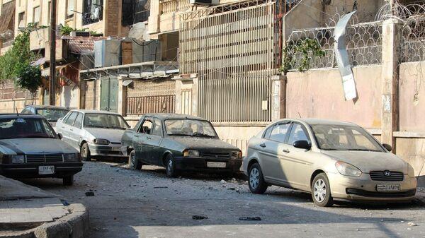 Квартал Аль-Акрамия в Алеппо после ракетного обстрела террористов