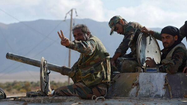 Бойцы армии САР прорвавшие трехлетнюю осаду города Дейр-эз-Зор в районе территории 137-й механизированной бригады