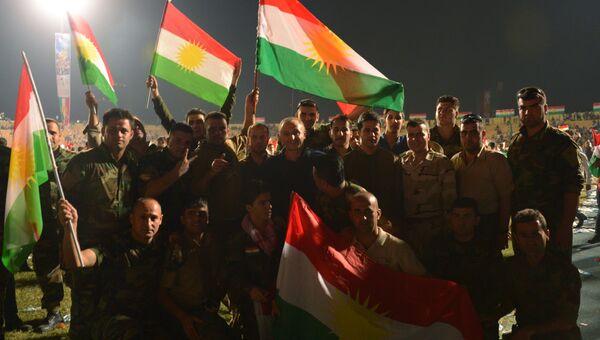 Бойцы курдской пешмерга на Фестивале независимости на стадионе Франсо Харири в Эрбиле. Архивное фото
