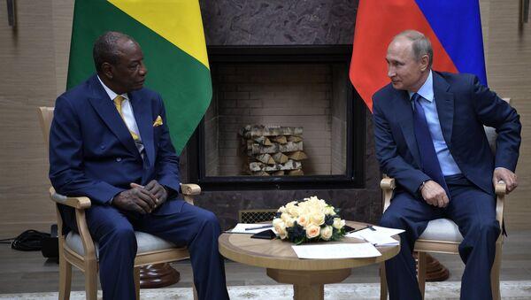 Президент Гвинейской Республики, действующий председатель Африканского союза Альфа Конде и  Владимир Путин во время встречи. 28 сентября 2017